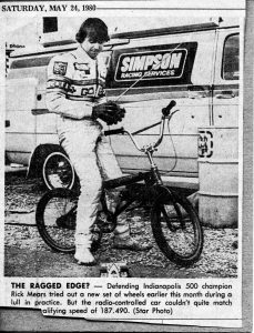Rick Mears on a BMX bike, playing with a remote controlled car.